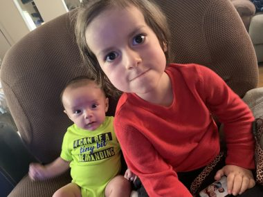 coping with emotions | Pompe Disease News | Cayden and his little brother sit on a chair together the day Cayden was released from the hospital.